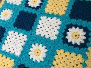 Granny square daisy blanket